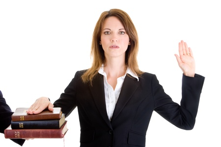White woman swearing on a stack of bibles photo