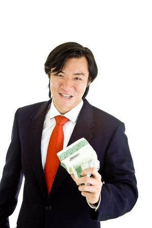 stock certificate: Grimacing Asian man crushing a stock certificate in anger.  Isolated on white background. Stock Photo