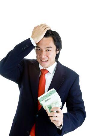 stock certificate: Hombre de negocios asi�tico la celebraci�n de un certificado de acciones arrugado con la mano en la cabeza Foto de archivo