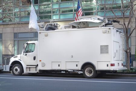 Television News Truck Van, Satellite Dish Roof, Parked on Street Stock Photo