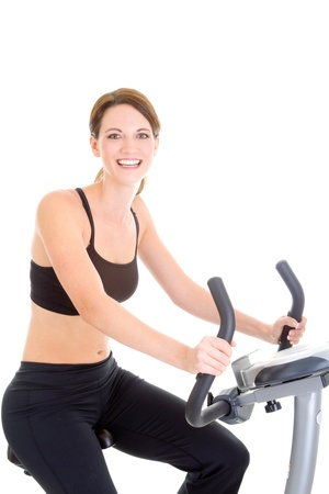Smiling white woman working out on an exercise bike