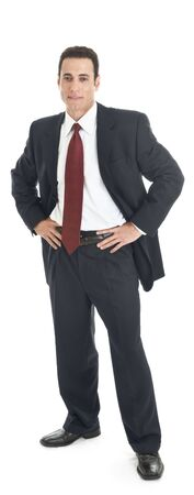 arms akimbo: White man in a suit, standing with hands on hips.  Full body shot, isolated on white. Stock Photo