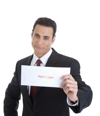 foreclosed: Smug looking businessman holding an envelope marked Foreclosed.  Isolated on white background. Stock Photo