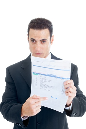 White businessman pointing to a past due medical bill.  Isolated on white background. Stock Photo
