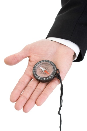sleeve: Mans hand with suit sleeve holding a compass in palm.  Isolated on a white background. Stock Photo