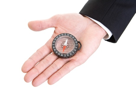 Mans hand in suit sleeve holding compass isolated on white background. photo