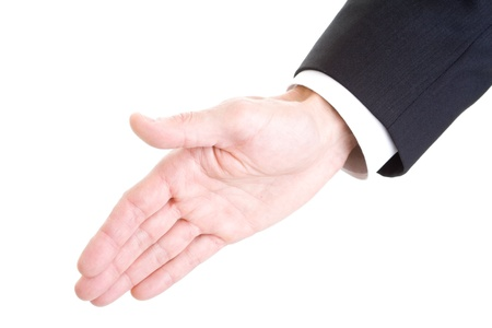 One man's hand extending for a hand shake.  Isolated on white background.
