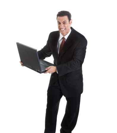 gritting: Angry Businessman Holding Laptop Isolated on White Background.  Looks like he is ready to throw or smash it Stock Photo