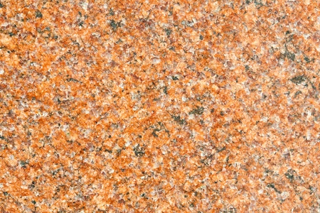 Closeup of polished granite.  Reddish color indicates a lot of iron in the stone. Banco de Imagens