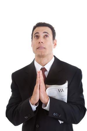 begging: Businessman Holding Business Section Newspaper Looking Up Praying Stock Photo