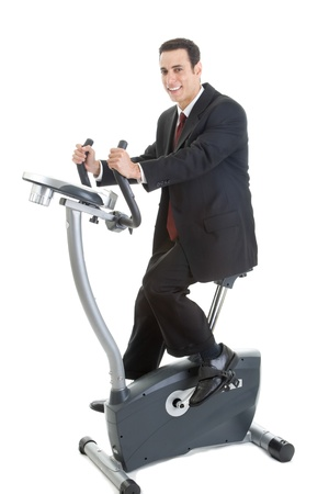 stationary bicycle: Happy Caucasian Man Suit on Exercise Bike Isolated White Background