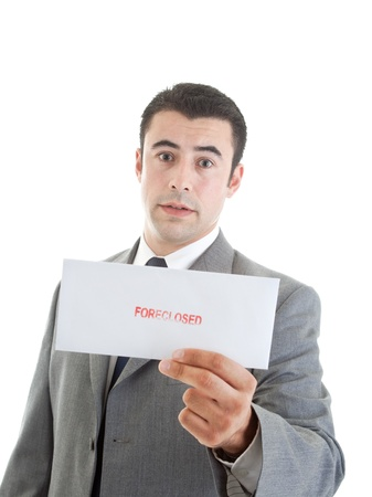 foreclosed: Hispanic man holding a letter stamped foreclosed focus on envelope