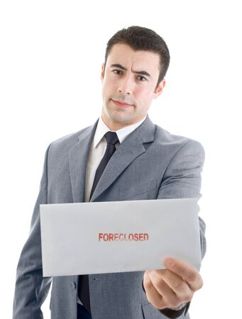 foreclosed: Hispanic man holding out an envelope marked foreclosed Stock Photo