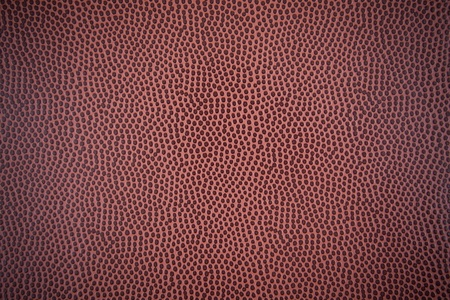 bumpy: Paper with a bumpy texture, similar to basketball bumps.