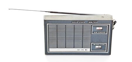 Vintage AM and police frequencies transistor radio.  Isolated on white background. Stock Photo - 11397456
