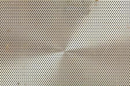 Closeup of a vintage metal speaker screen from a transistor radio Stock fotó