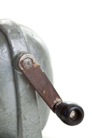 hand crank: Crank handle to an old pencil sharpener Stock Photo