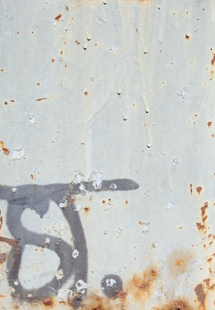 Full frame gray metal surface with paint drips, rust spots, and graffiti. photo