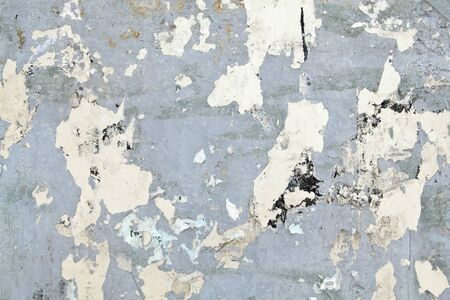Full Frame Grungy Gray Metal with Peeling Paper Scraps from posters Stock Photo - 11397196