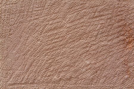 chiseled: Full Frame Rough Red Sandstone Wall Stock Photo