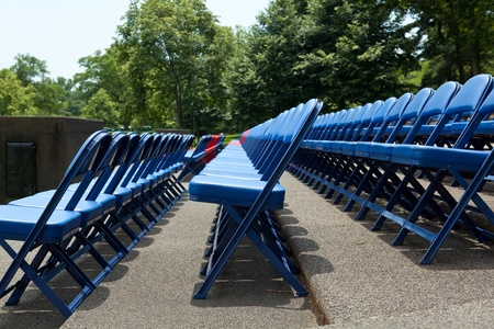 folding chair: Outdoor rows of blue and red metal folding chairs