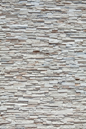 Vertical full frame sandstone stone wall made from many individual blocks. Stock Photo - 11397179