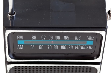 Close-up of a vintage plastic transistor radio tuner display on an isolated background. photo
