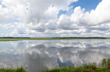 natural  moody: Dramatic puffy white clouds reflected in the May River, Bluffton, South Carolina Stock Photo
