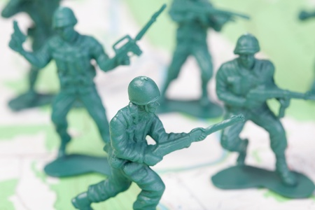 plastic soldier: Plastic Army Men Fighting on Topographic Map. The map was produced by the U.S. Geological Survey and is in the public domain Stock Photo