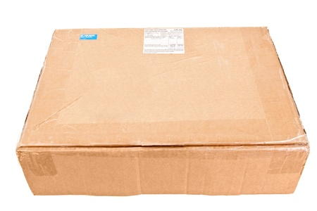 internationally: Cardboard Box Shipped Internationally from the UK, Has customs declaration, air mail sticker and stamps Stock Photo