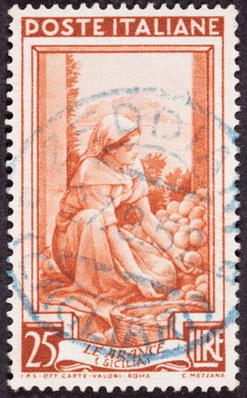 Drawing Woman Sorting Fruit, Used Italian Stamp, Cancelled Cancellation Stock Photo