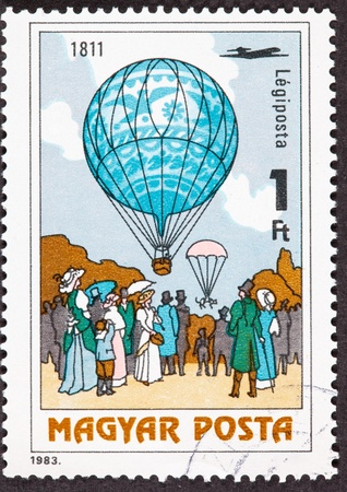 magyar: Hungarian Air Mail Postage Stamp. Dr. Menner Dropped Cat With Parachute over side of balloon in 1811.  The cat survived.
