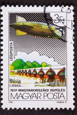 franked: Used Hungarian Postage Stamp Flight, Graf Zeppelin crossing a Bridge or Dam on its historic around the world flight in 1931