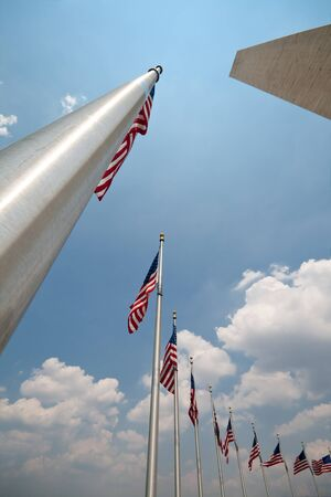 Wide Angle American Flags and Flagpoles at the Washington Monument, in Washington DC.