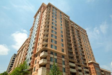 rosslyn: Horizontal modern apartment building against blue sky in Rosslyn, Virginia