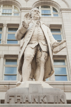 Statue of Ben Franklin, the founder of the U.S. postal system. Outside the Old Post Office building in downtown Washington DC.