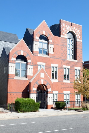 Modern Take on a Classic Brick Richardsonian Romanesque Style Row Home Capitol Hill, Washington DC  It has recessed arched door and the short columns around the windows of the Richardsonian Romanesque Style Stock Photo - 11379635