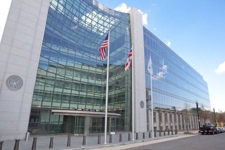 flagpoles: Securities and Exchange Commission, SEC, Building in Washington DC.  The SEC regulates stocks and bonds and related financial activities.