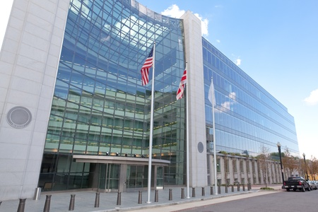 regulating: Securities and Exchange Commission, SEC, Building in Washington DC.  The SEC regulates stocks and bonds and related financial activities.
