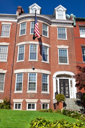 Well maintained Georgian style brick townhouse with American flag.  Upscale neighborhood, Washington, DC, USA.  Front view Stock Photo - 11379698