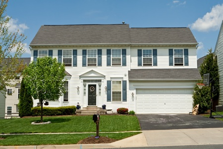 house siding: Single Family House with Vinyl Siding and Garage