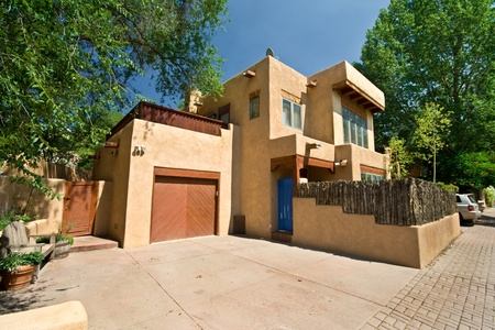 Wide angle shot of modern adobe home in Santa Fe, New Mexico