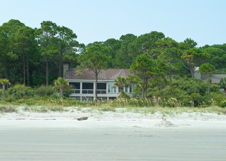 head home: Modern single family home on the beach at Hilton Head Island, South Carolina. Sand dunes, Sea Oat beach grass, and beach in the foreground.