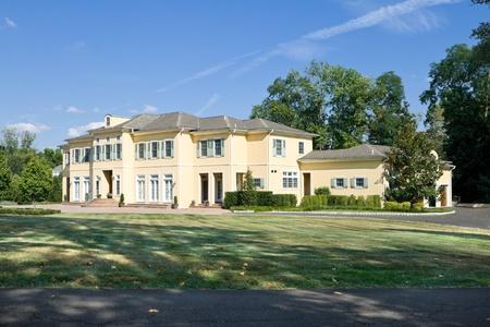 New single family home in suburban Philadelphia, Pennsylvania PA.  French Provincial style. Editorial