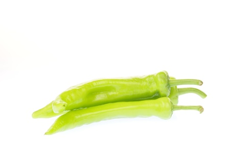 White background on the green peppers, filmed in the studio  photo