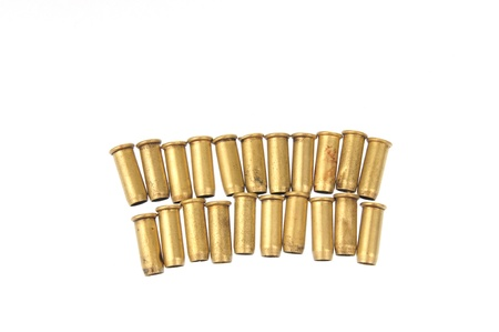 casings: The bullet casings on the white background and filming in the studio  Stock Photo