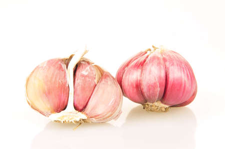 The garlic on the white background and filming in the studio  photo