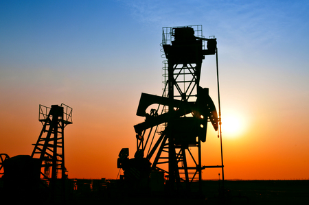 wells: Oil pump in the sunset, taken in the river south, in the north of China