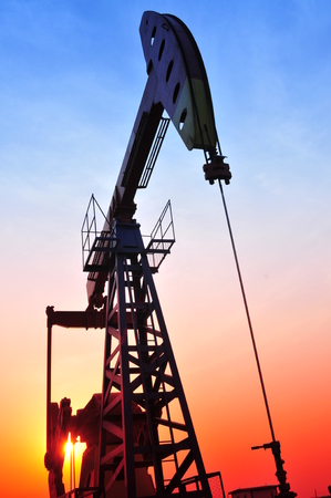 Oil pump in the sunset, taken in the river south mouth, in the north of China photo