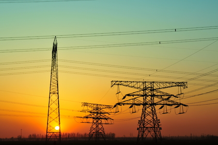 sunset: High voltage power lines at sunset Stock Photo